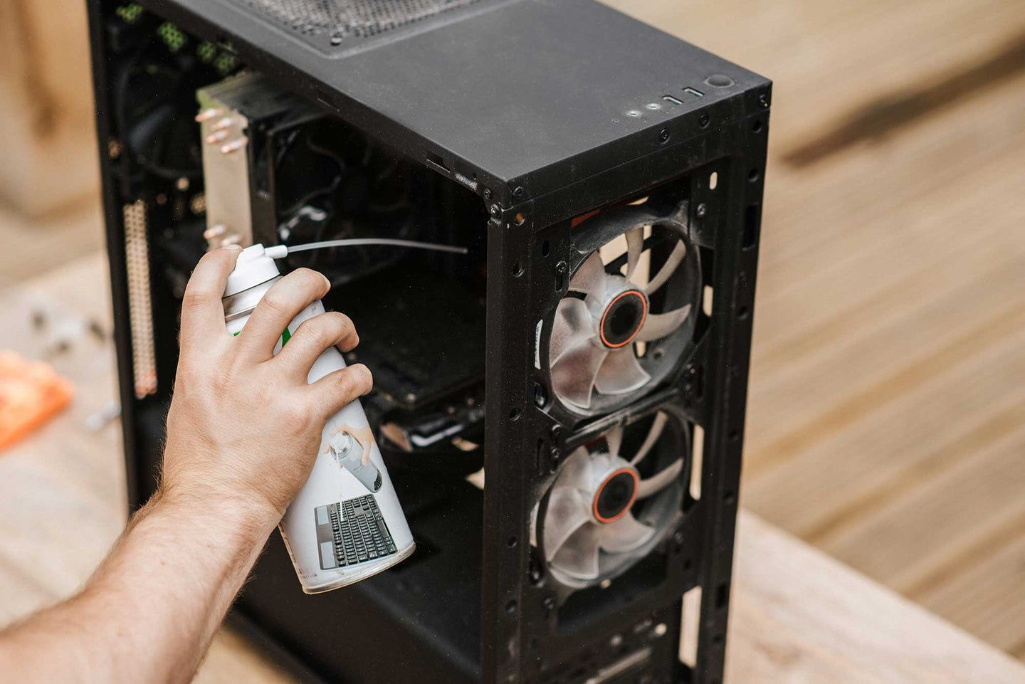 Person cleaning computer interior