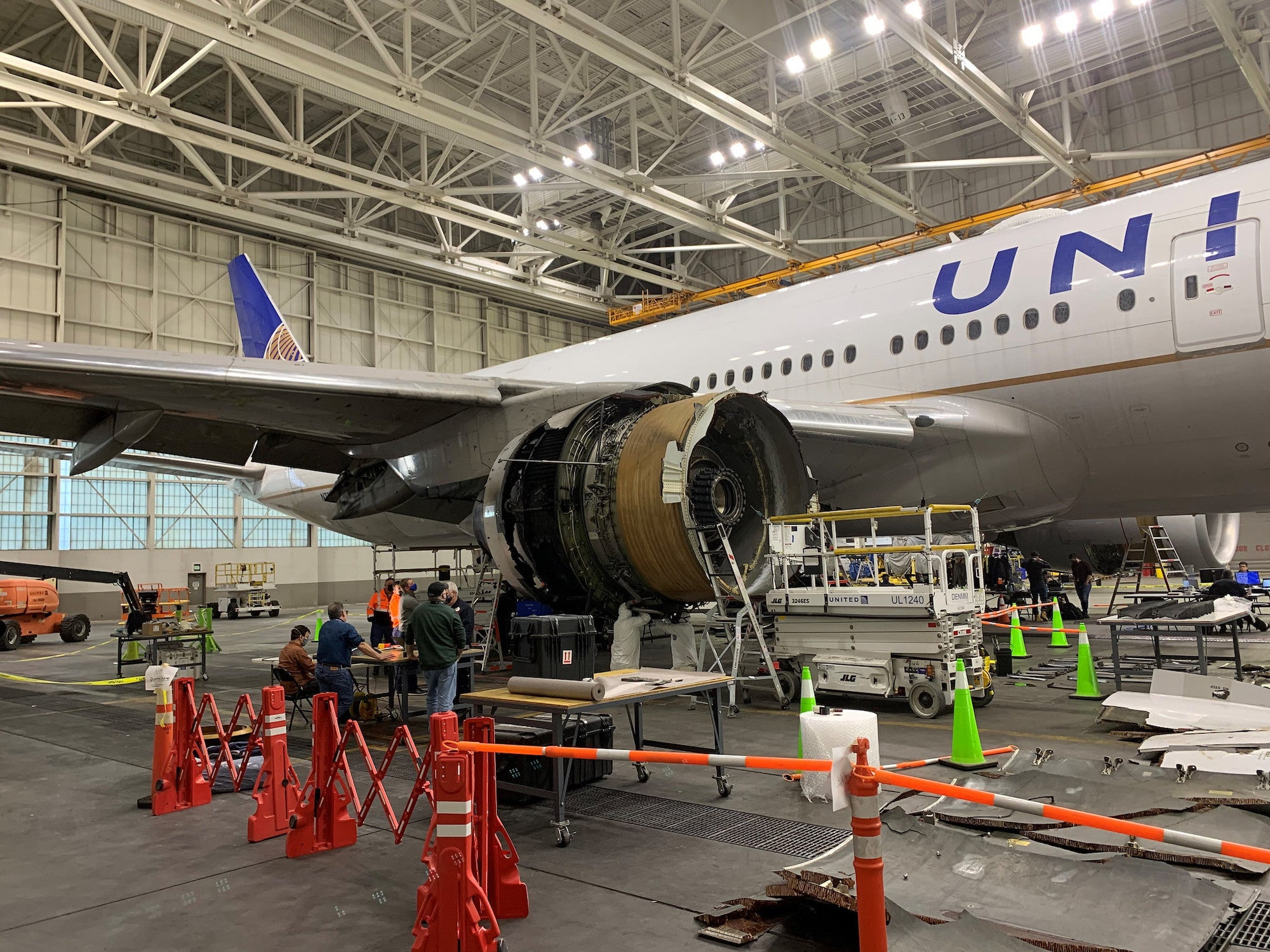 Boeing's damaged 777-200 parked in a hanger following an incident with its engine on Flight 328 on February 20.