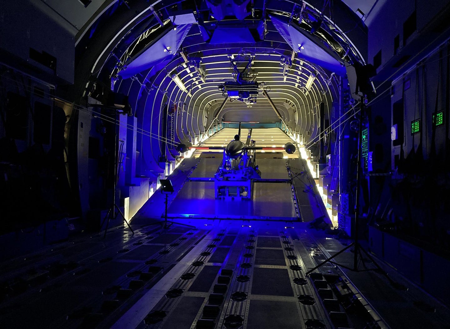 A drone in a launcher in the back of a cargo aircraft.