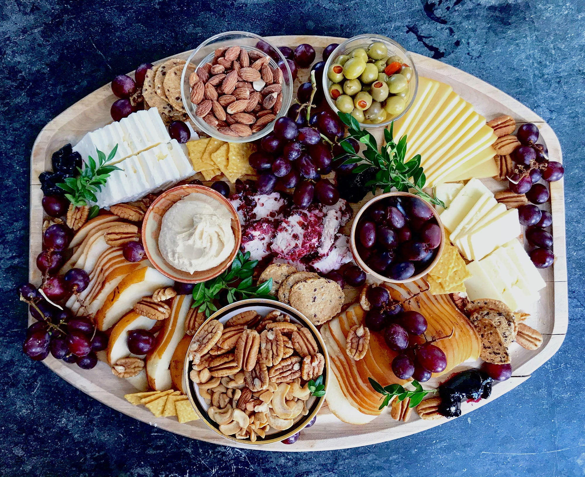 food platter with meats, cheeses, and fruits