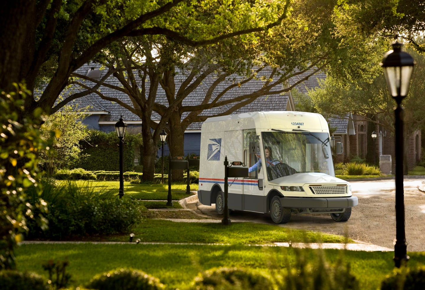 New USPS mail delivery truck in a simulated suburb