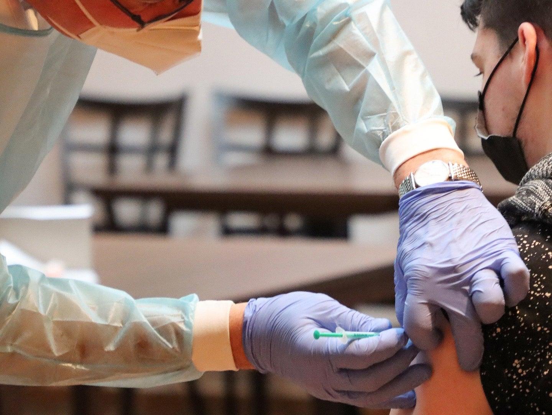 a person getting the COVID-19 vaccine