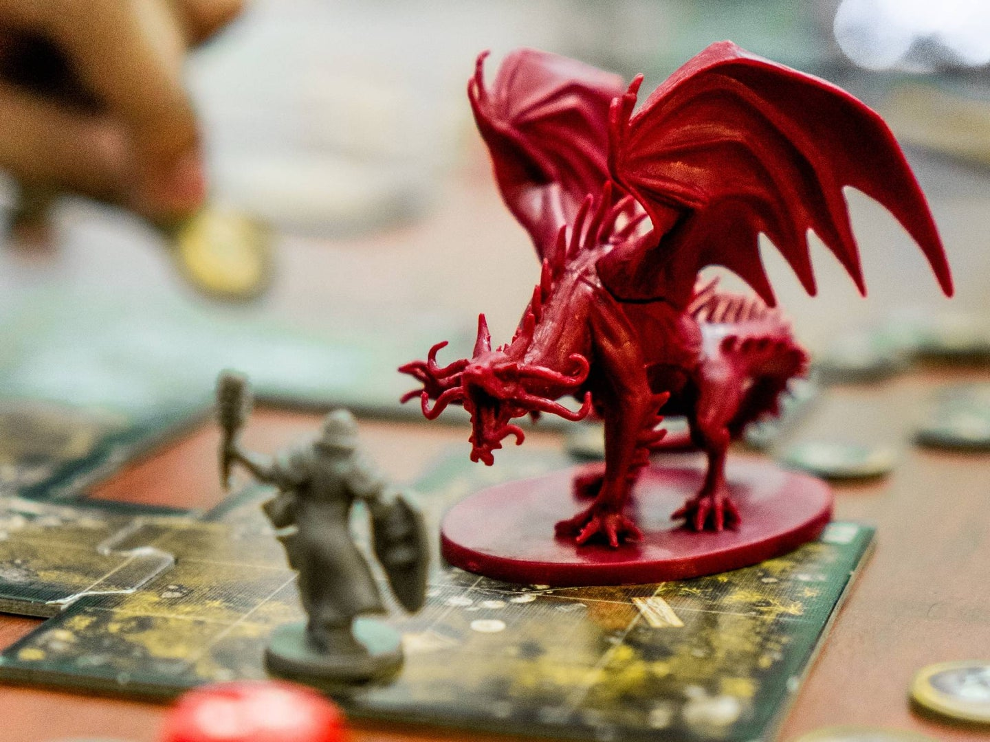 A plastic piece depicting a menacing plastic dragon on a board game