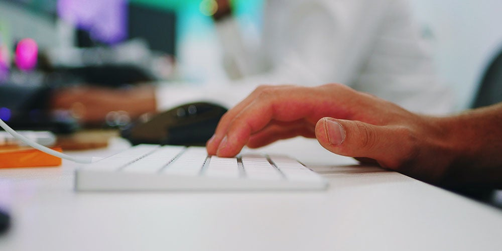 person typing on a keyboard