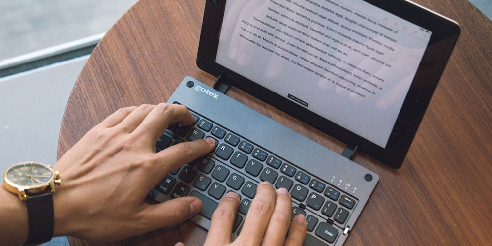 Foldable Bluetooth Keyboard with Built-In Stand