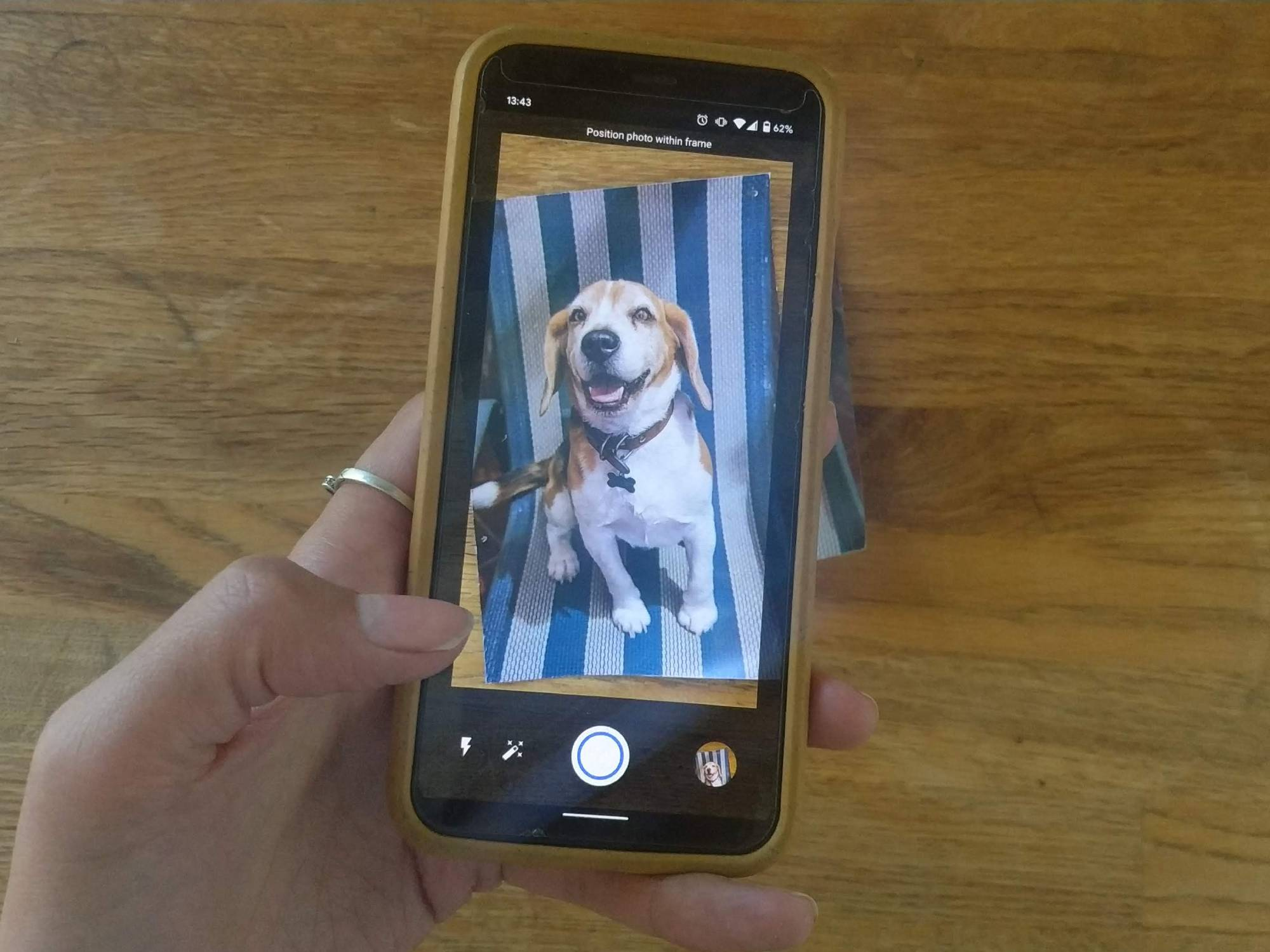 Smartphone using the app Google PhotoScan to scan a printed photo