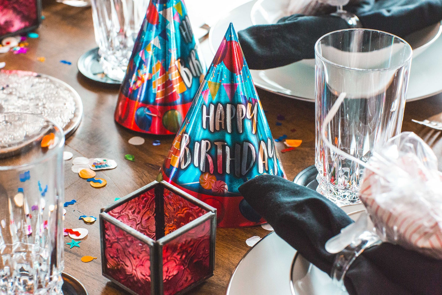 table with birthday hats and other festive items