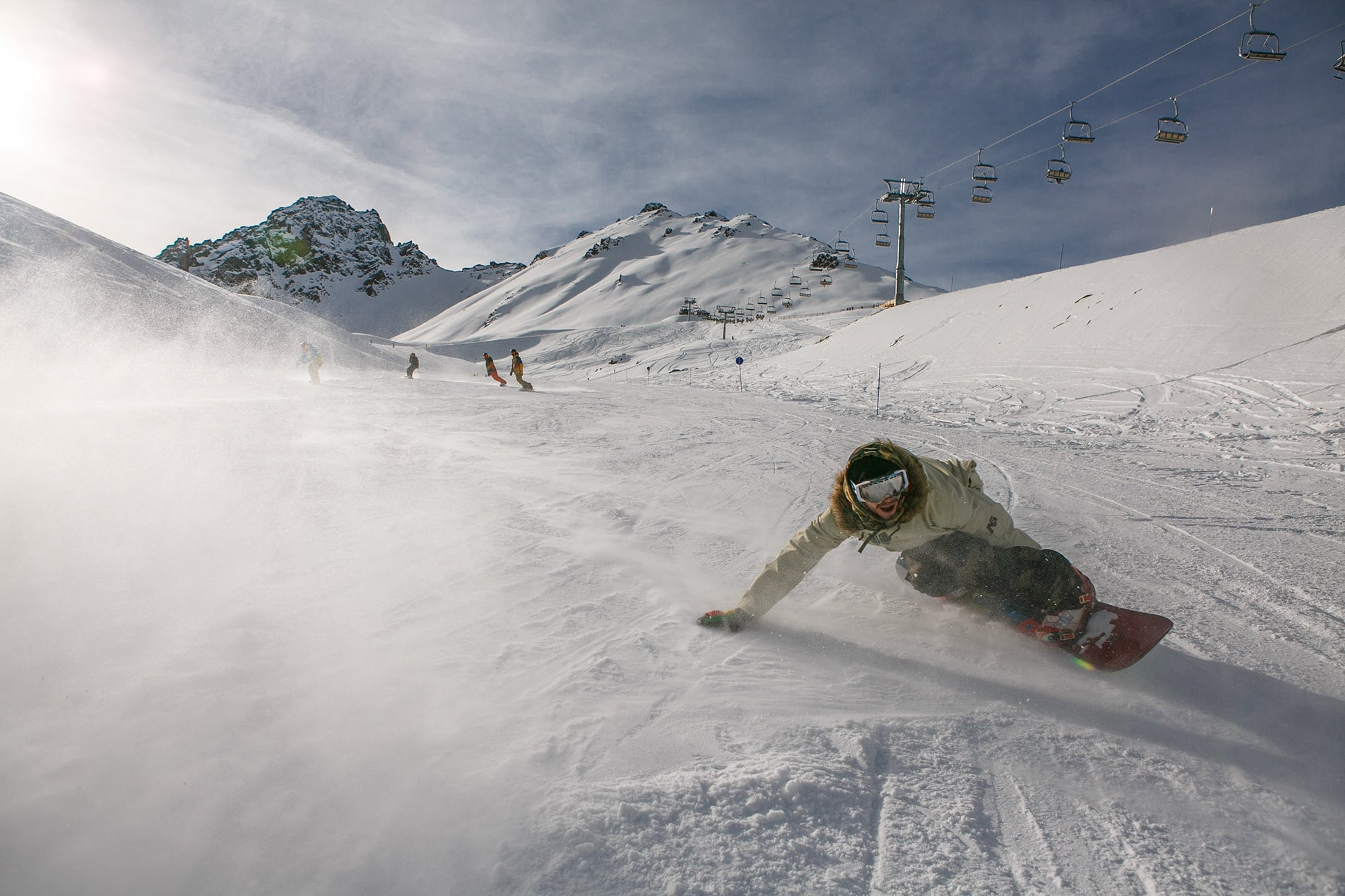 person snowboarding down a mountain wearing the best snowboard helmet