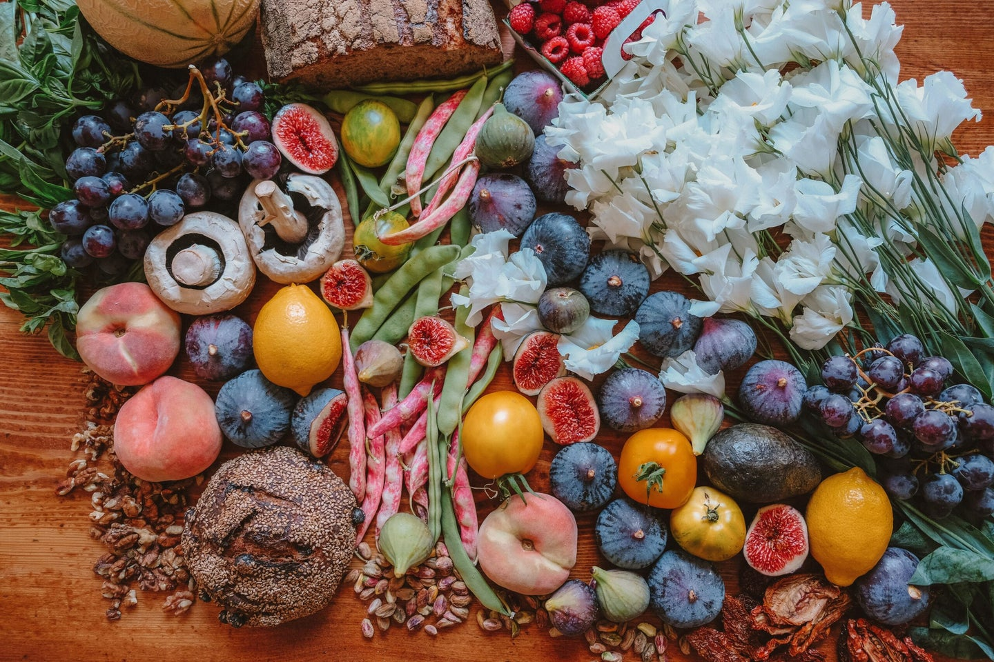 Assorted fruits, mushrooms, vegetables and other food spread out on table