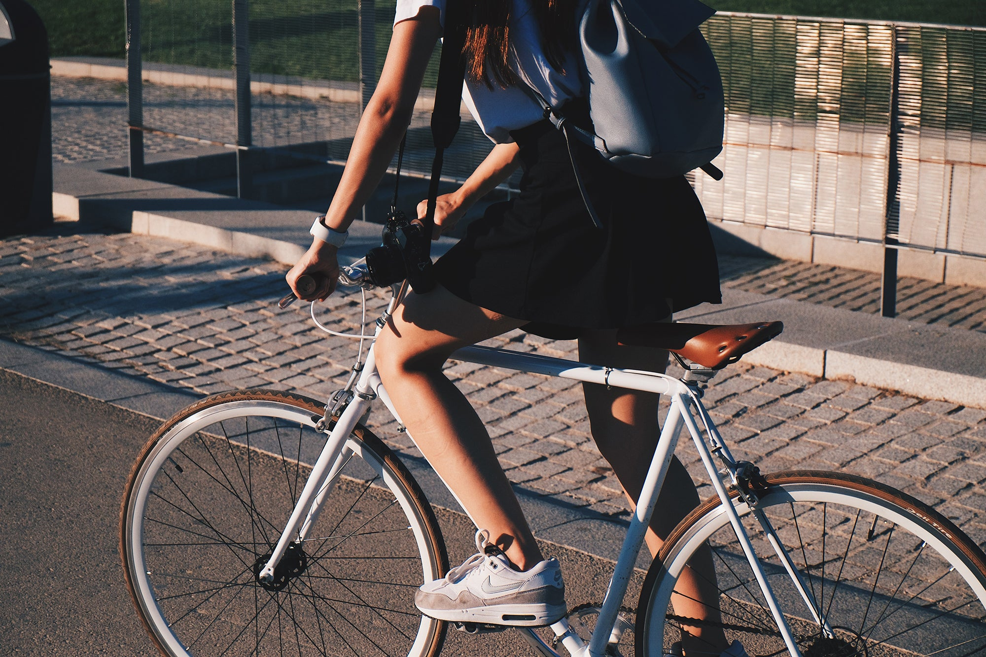 woman on a bike with a backpack