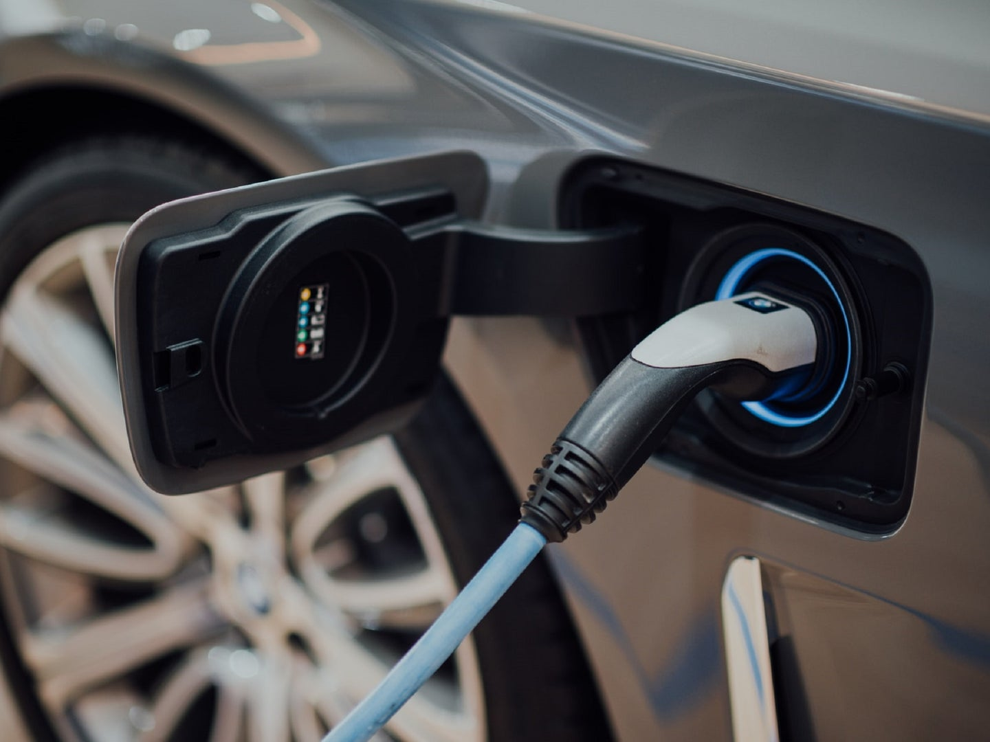 Electric vehicle plugged into a charging station