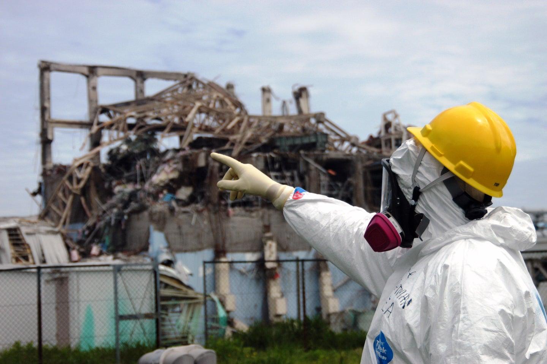 investigator examines Reactor Unit 3 at the damaged Fukushima Daiichi plant