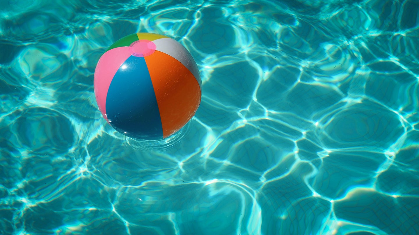 beach ball in a pool cleaned by the best pool vacuum