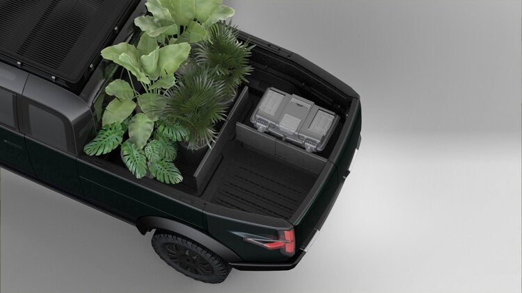 Canoo electric pickup truck with modular bed dividers