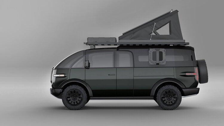 Canoo electric pickup truck with a camper cap