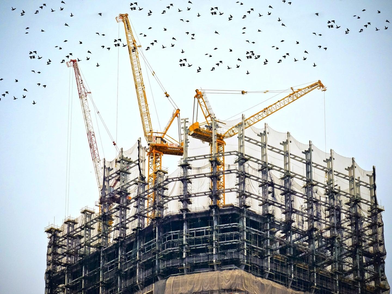 cranes building a skyscraper