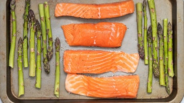 Salmon and asparagus on a cooking sheet