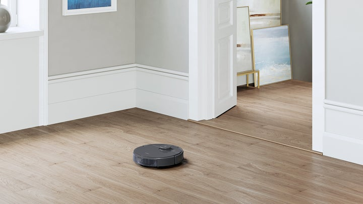 T8 Osmo vacuum and mopping robot on a wooden floor