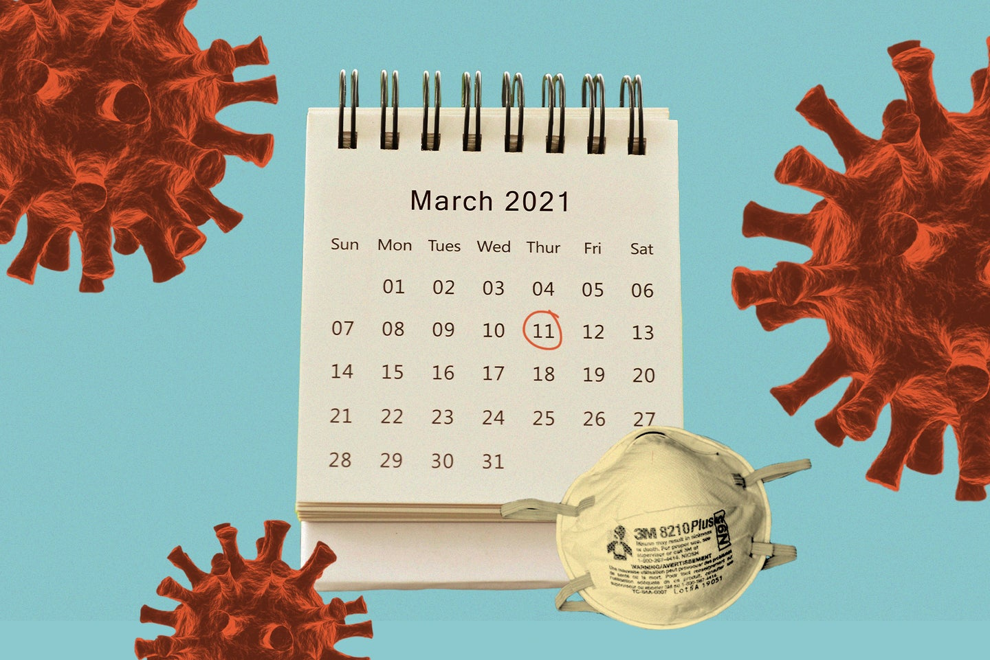 A calendar with the page for March 2021 displayed and a red circle around Thursday the 11th sits next to an N95 mask on a blue background surrounded by red illustrations of the coronavirus.