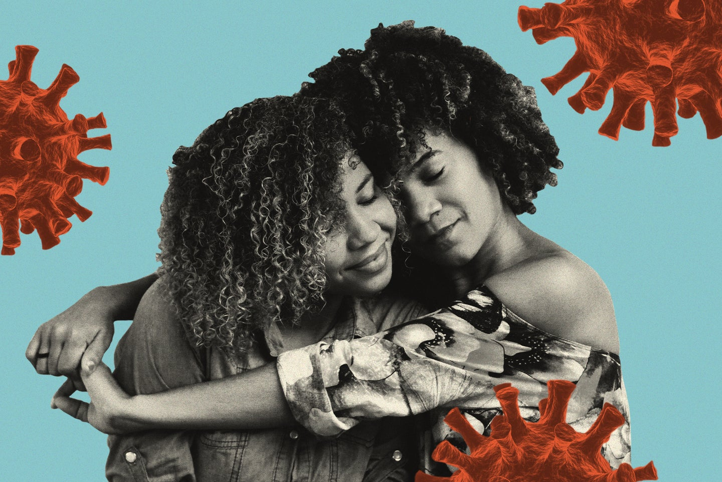 Two Black women with curly hair hug against a blue background featuring red coronavirus illustrations