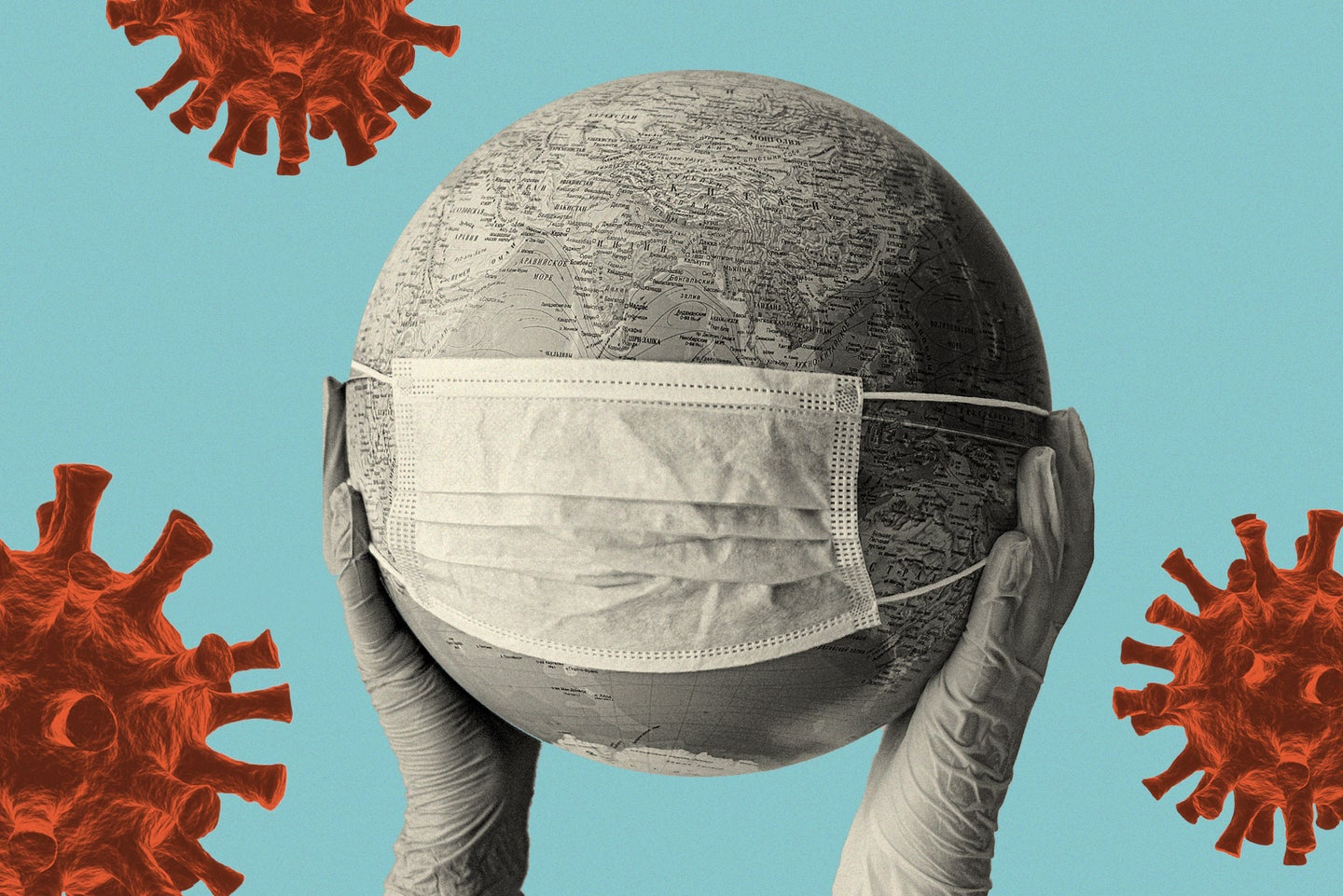 two gloved hands hold up a black and white globe with a medical mask stretched over it against a blue background with several red coronaviruses on it