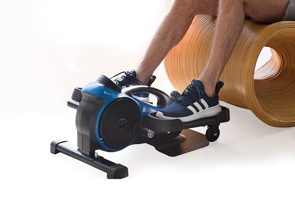 person sitting on a wooden chair using a exercise machine