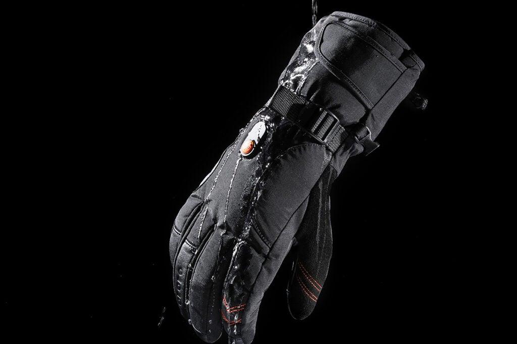 black heated gloves over a black background