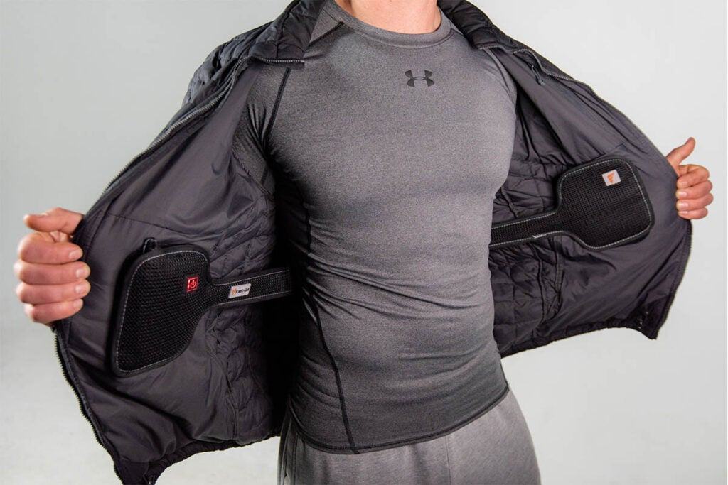 person in workout clothing with a heated jacket on