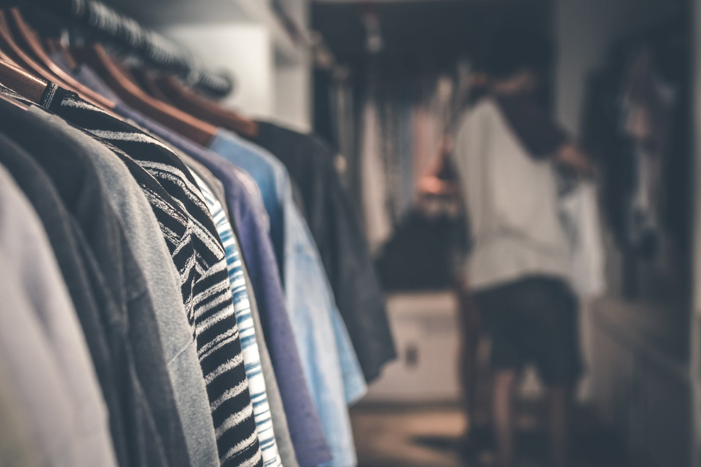 clothing on hangers in a walk-in closet with the best closet organizer.