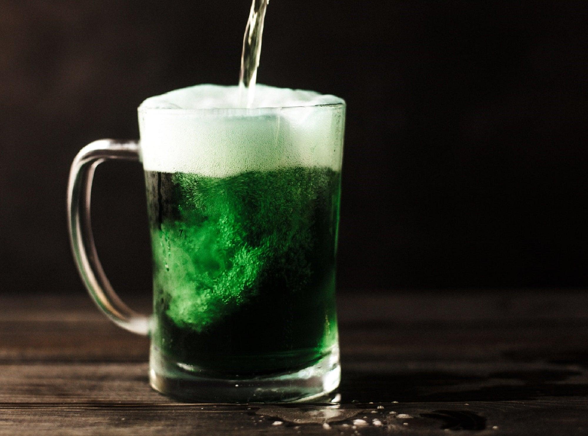 Mug of green beer being poured