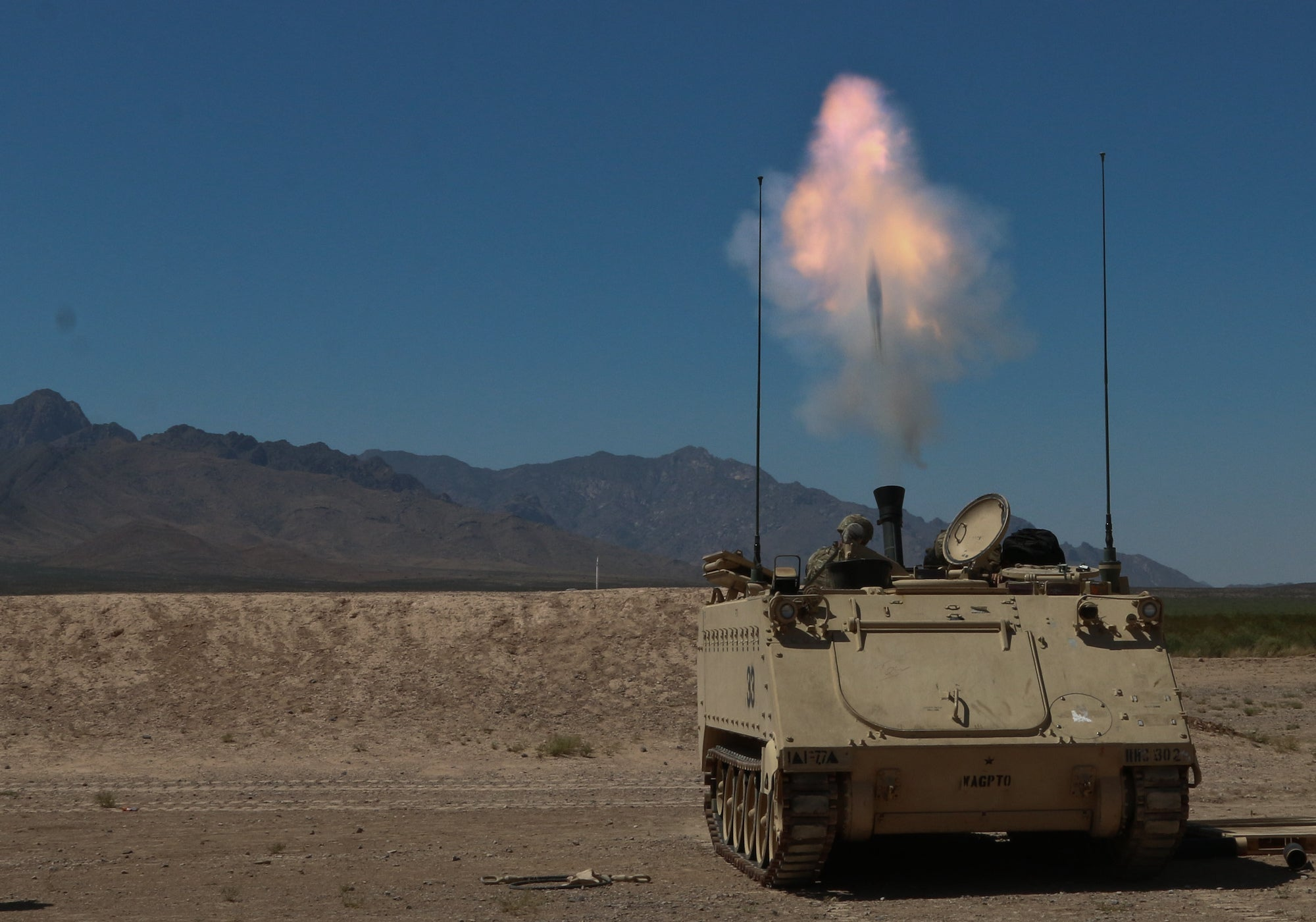 A 120mm mortar fires from a military vehicle.