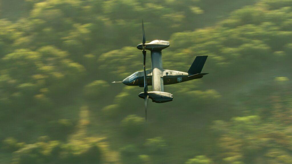 A V-280 Valor flying over a forest.