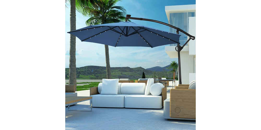 patio furniture with an umbrella over it
