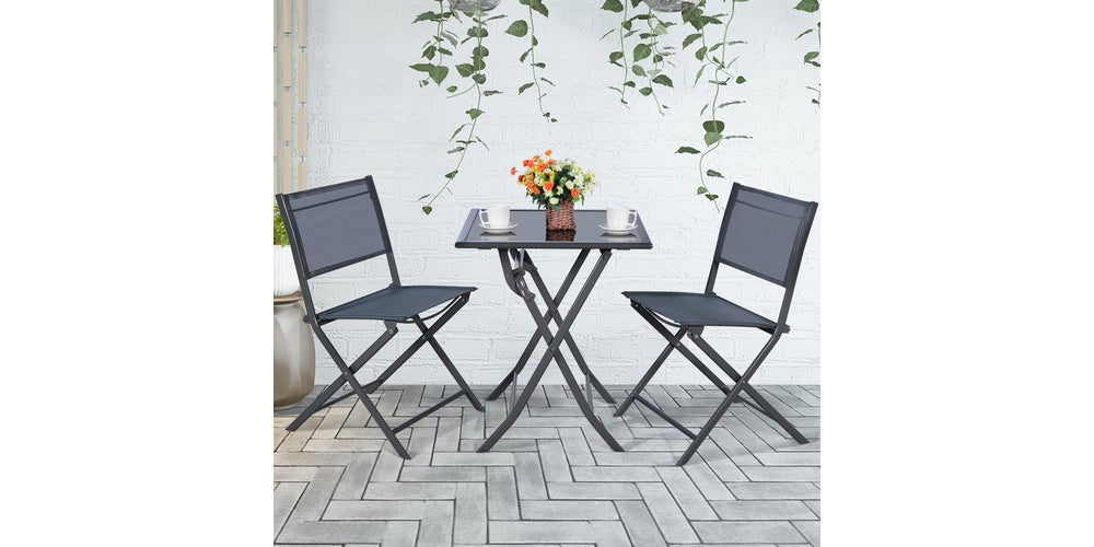 two chairs and a table on a patio
