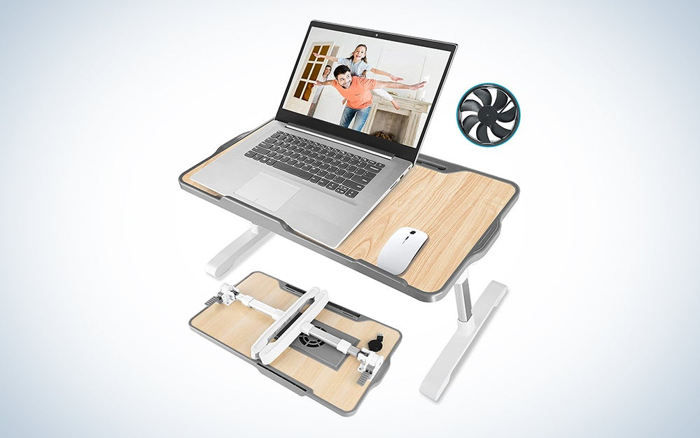 laptop on a wooden laptop stand