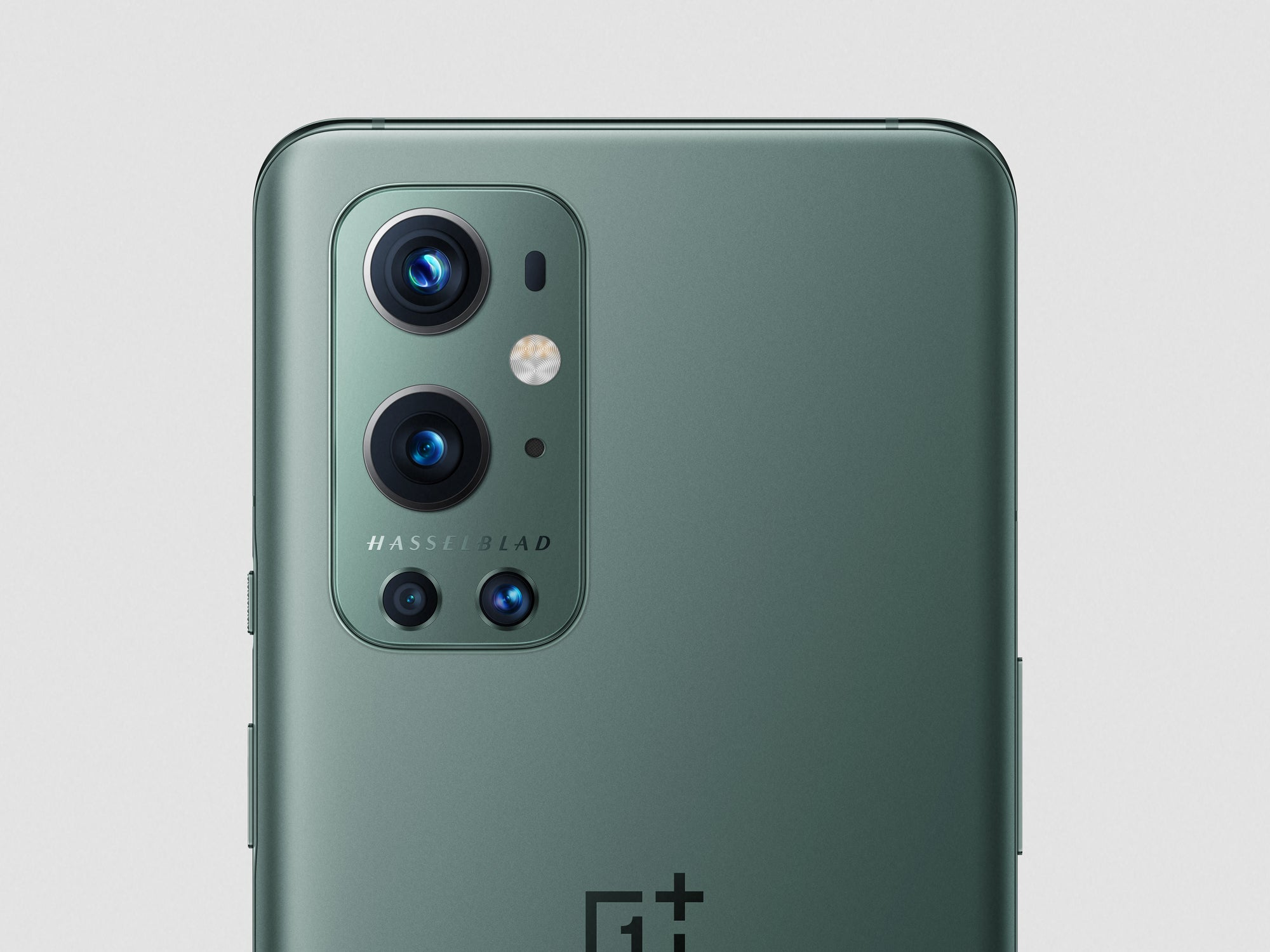 A close-up of the OnePlus 9 Pro cameras on white background.