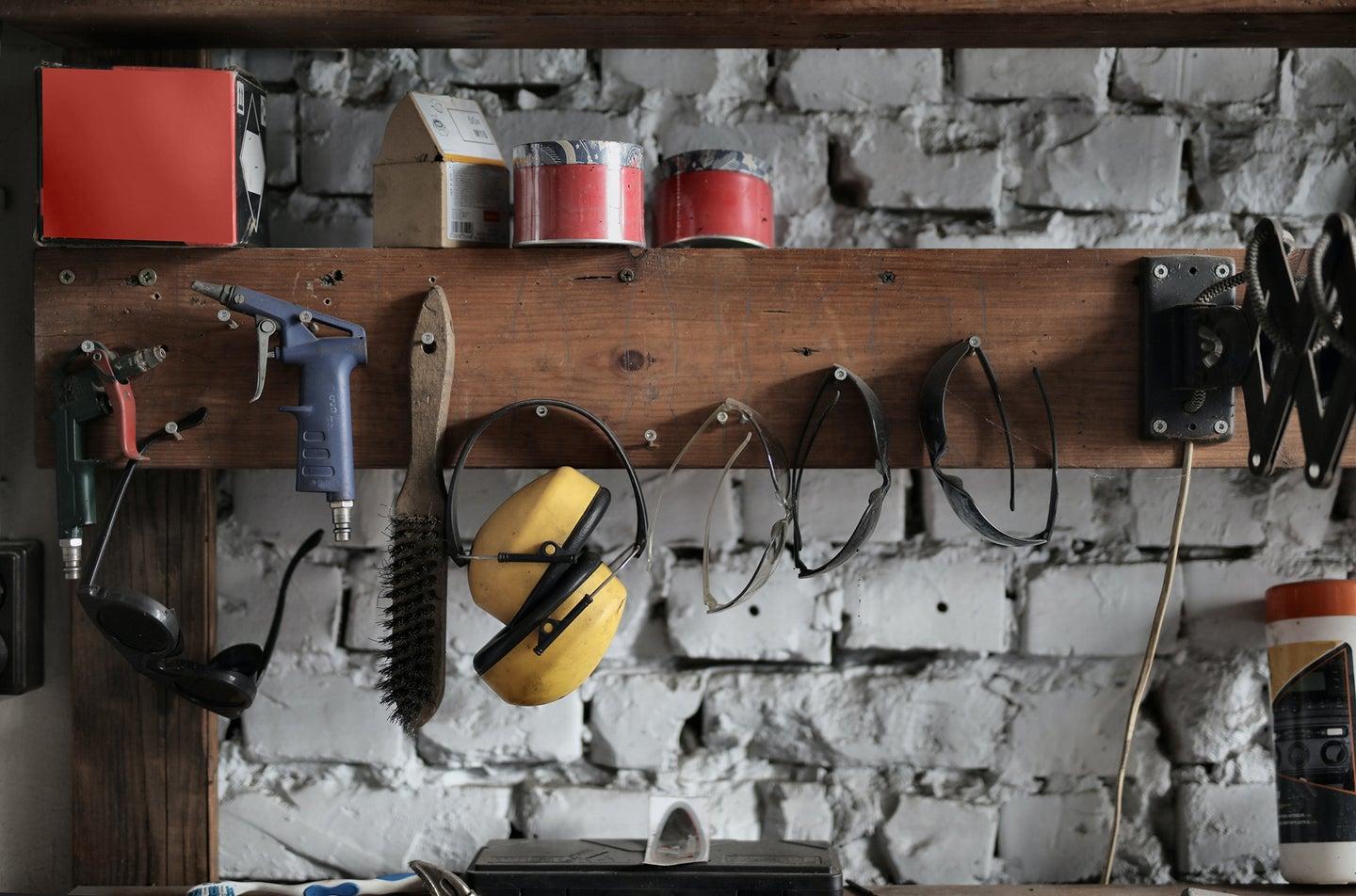garage wall with tools hung on a wall storage unit