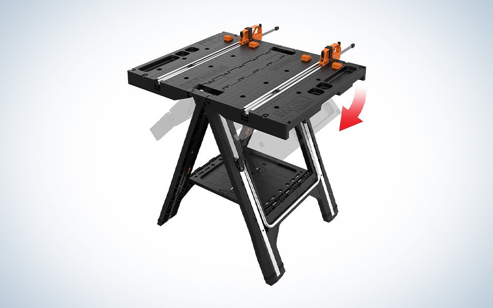 black wood workbench with orange clamps