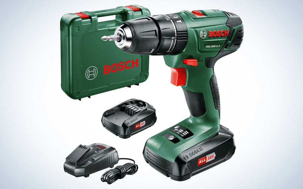 green cordless drill with battery, charger, and carrying case