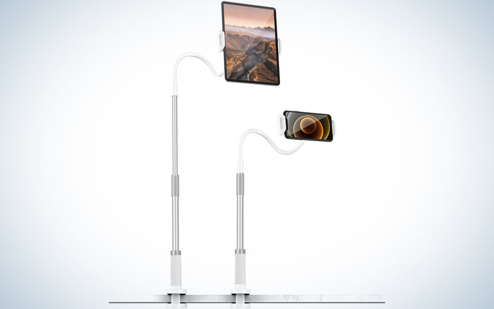 a tablet and smartphone each held on a gooseneck stand clamped to a desk