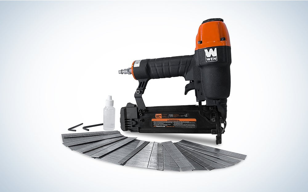 nail gun with nails in front of it