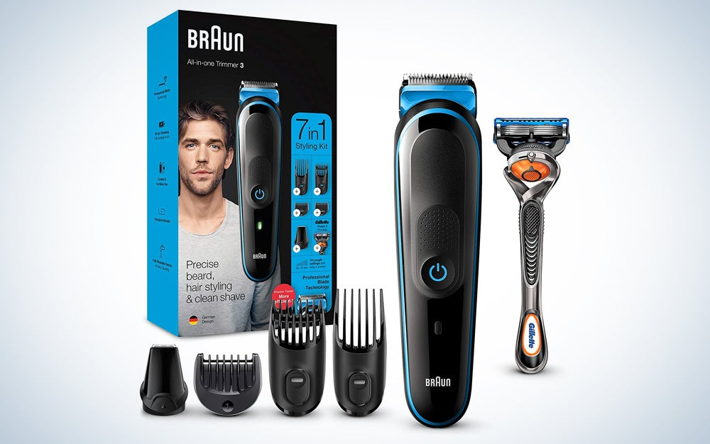 black and blue clippers with hair guards, a razor, and box