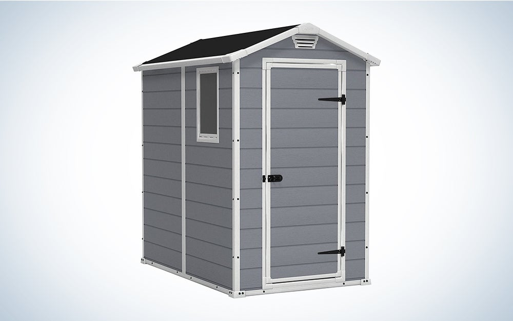gray storage shed with white trim