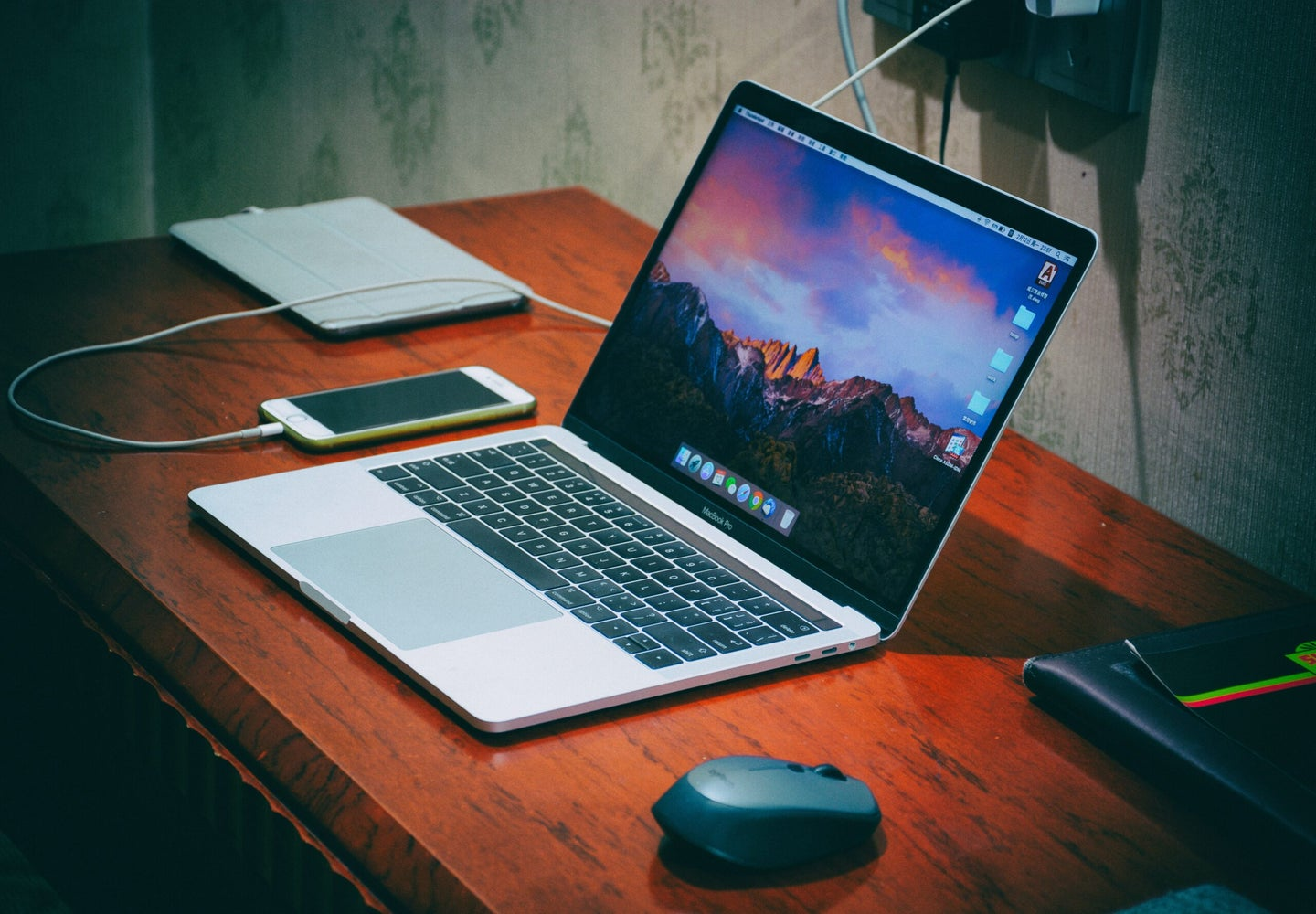 usb-c compatible macbook sitting on a desk with phone and wireless mouse