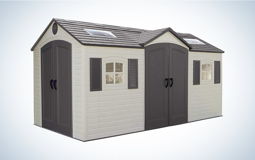 large grey and beige storage shed