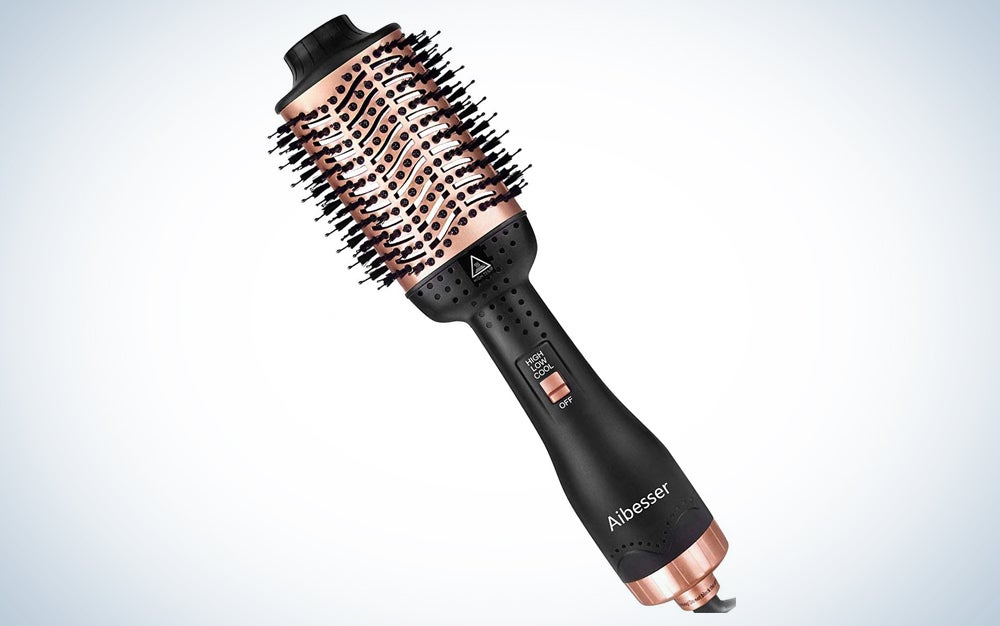 rose gold hot air hair brush with black handle