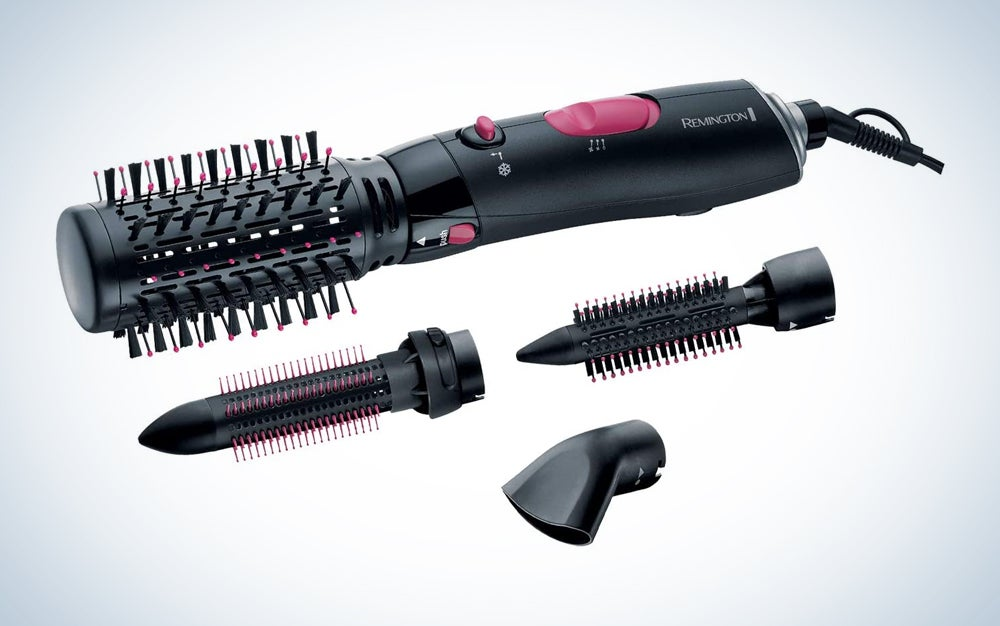 black hot air hair brush with button on/off switch and three attachments