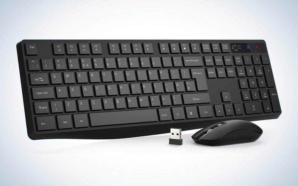 black wireless mouse with dongle and keyboard