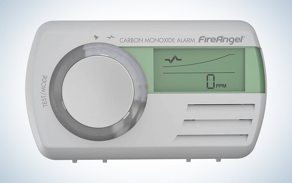 white carbon monoxide alarm with green digital screen