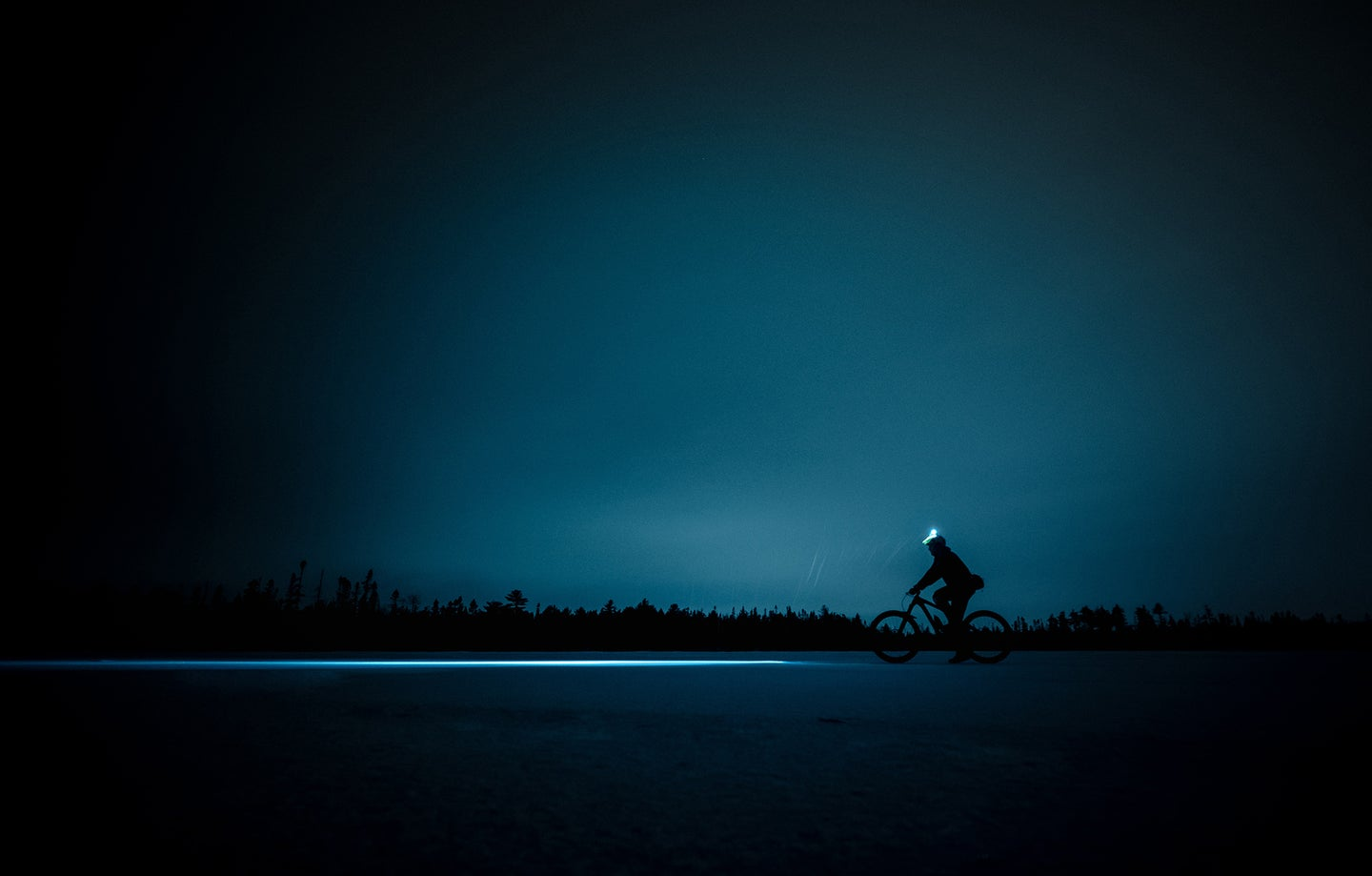 person on a bike with a headlamp